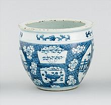 BLUE AND WHITE PORCELAIN JARDINIÈRE In ovoid form with figural cartouches on a cracked-ice and floral ground. Diameter 6.25
