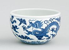 BLUE AND WHITE PORCELAIN JARDINIÈRE With five-claw dragon design. Six-character Qianlong mark on base. Diameter 8.7