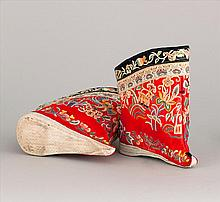 PAIR OF RED SILK EMBROIDERED LOTUS BOOTS With upturned toe and heavily embroidered with a deer, bird, squirrel, flowers, vines, and...