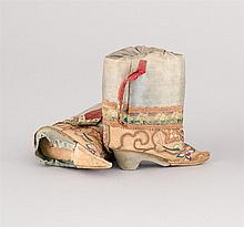 PAIR OF SILK EMBROIDERED MINIATURE BOOTS Green and beige silk with intricate floral embroidery. Joined by two silk threads so as to...