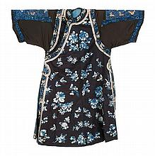 SILK NEEDLEWORK ROBE With butterfly and flower design on a dark blue ground.
