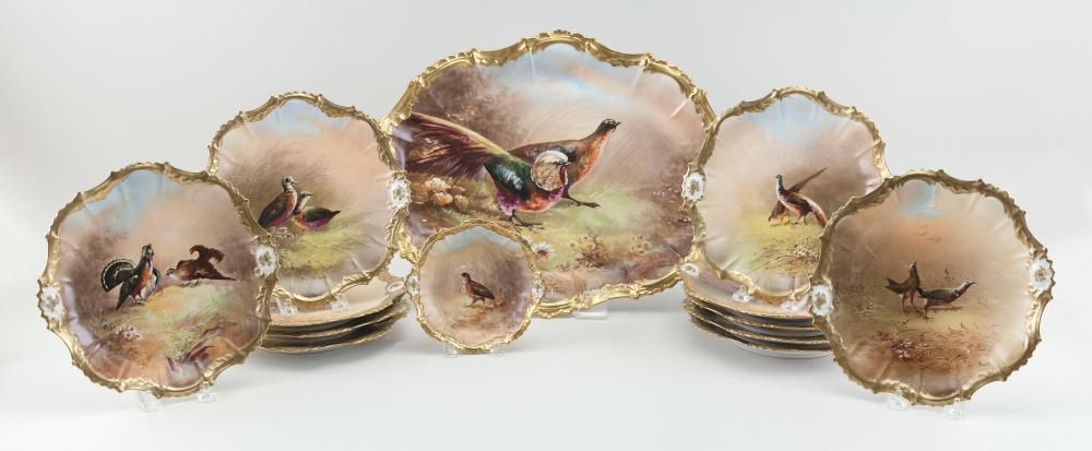 """LIMOGES PORCELAIN PLATTER AND TWELVE PLATES Early 20th Century Platter length 18.5"""". Plate diameters 6"""" and 9.5""""."""