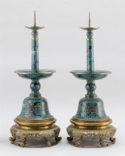 Lot 901: PAIR OF CHINESE CLOISONNÉ ENAMEL PRICKET CANDLESTICKS With medial drip pans, bell-form bases and passionflower decoration on a blue...