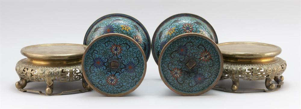 PAIR OF CHINESE CLOISONNÉ ENAMEL PRICKET CANDLESTICKS With medial drip pans, bell-form bases and passionflower decoration on a blue...