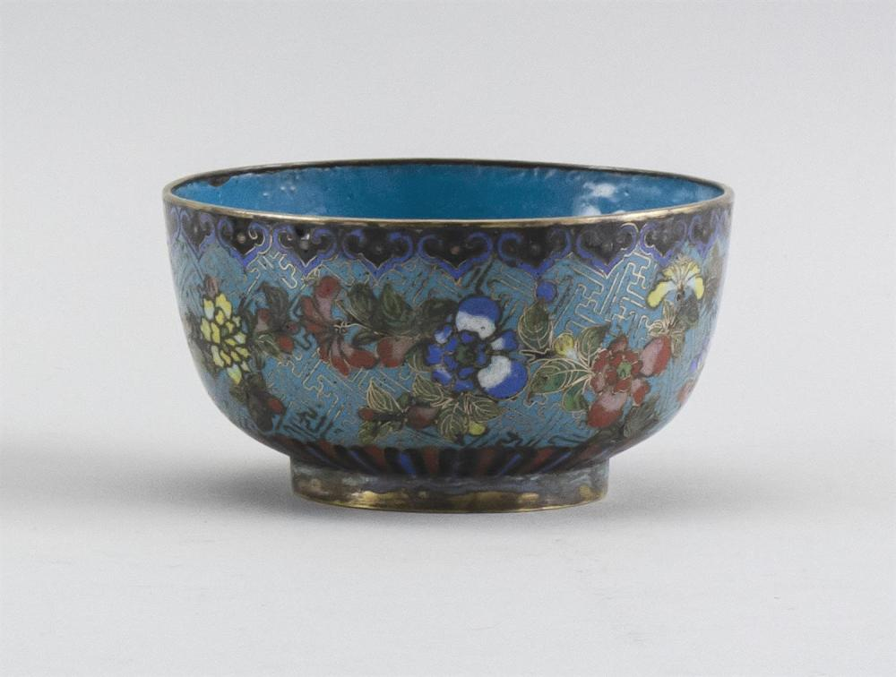CHINESE CLOISONNÉ ENAMEL BOWL With gilt rim, turquoise interior and colorful exterior decoration of a floral design on a turquoise g...