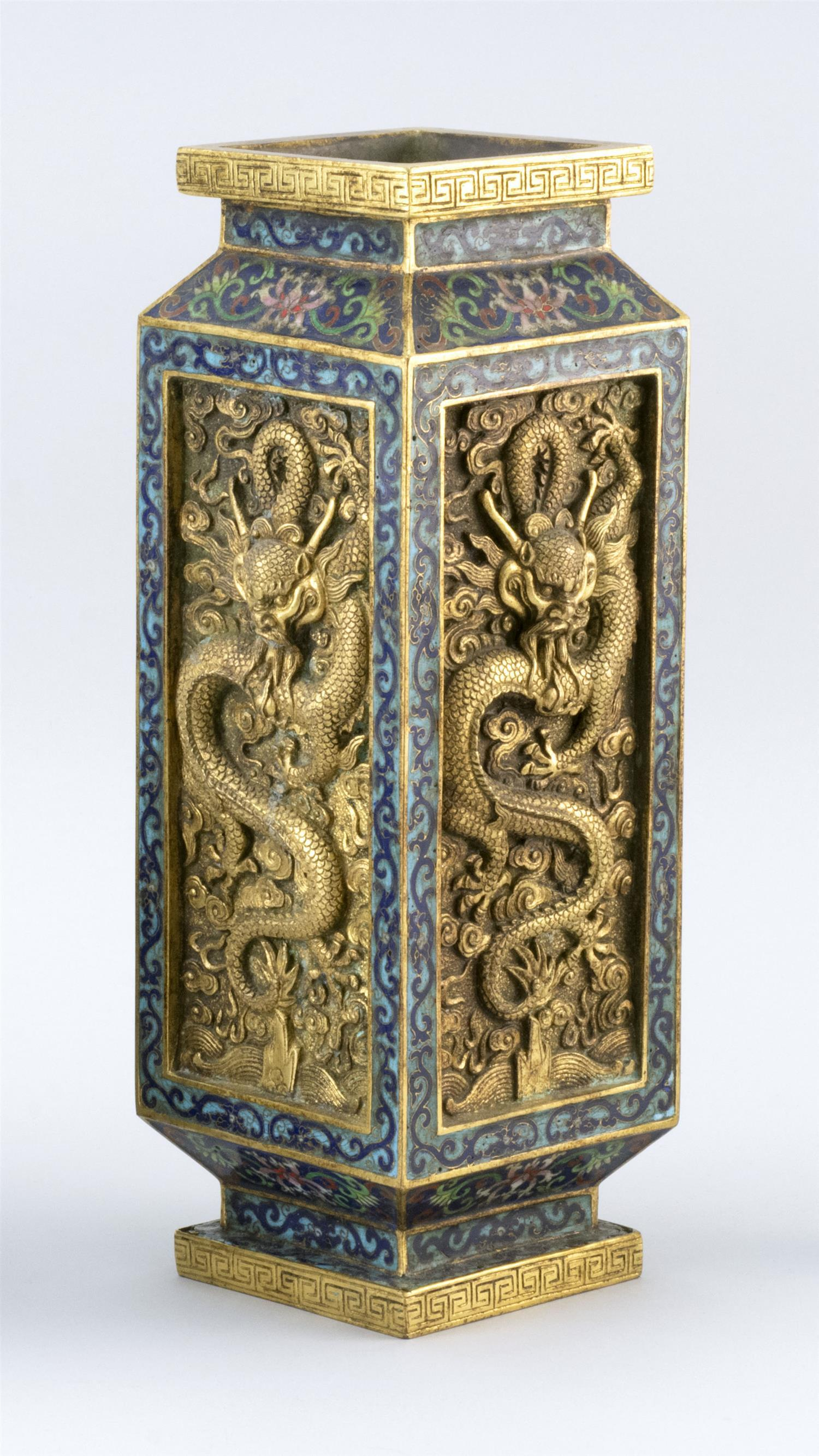 CHINESE GILT-BRONZE AND CLOISONNÉ ENAMEL VASE Rectangular, with gilt five-clawed dragon panels on a blue flower and vine ground. Fou...