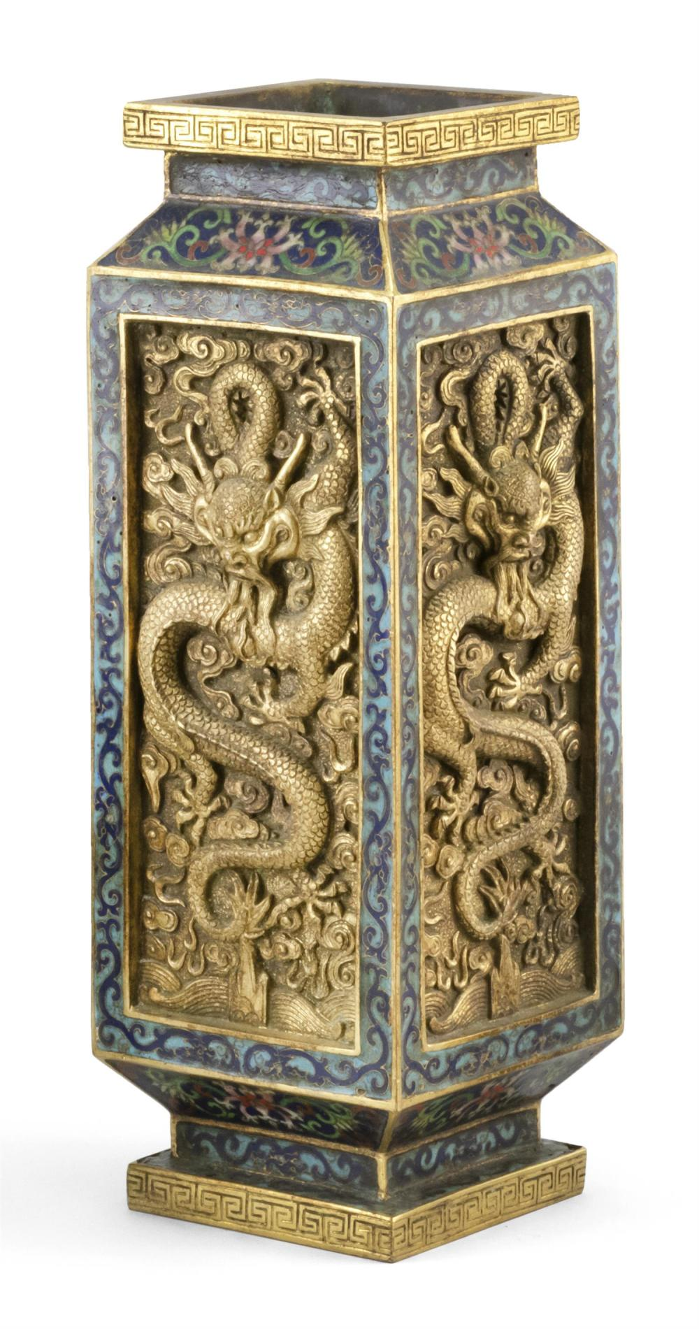 Lot 908: CHINESE GILT-BRONZE AND CLOISONNÉ ENAMEL VASE Rectangular, with gilt five-clawed dragon panels on a blue flower and vine ground. Fou...