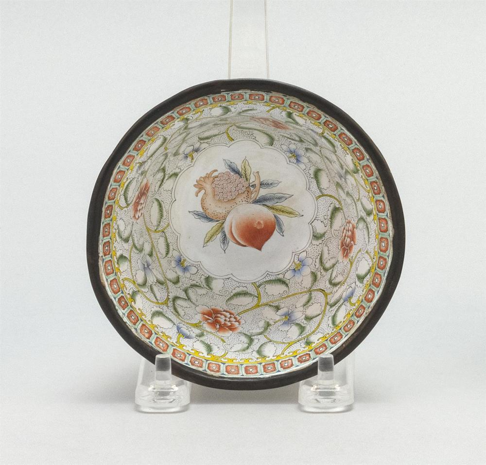 CHINESE PAINTED BEIJING ENAMEL CUP In bell form, with fruit and flower design. Four-character Qianlong mark on base. Diameter 4.3