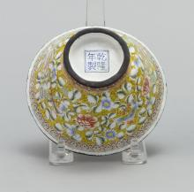 """Lot 910: CHINESE PAINTED BEIJING ENAMEL CUP In bell form, with fruit and flower design. Four-character Qianlong mark on base. Diameter 4.3""""."""