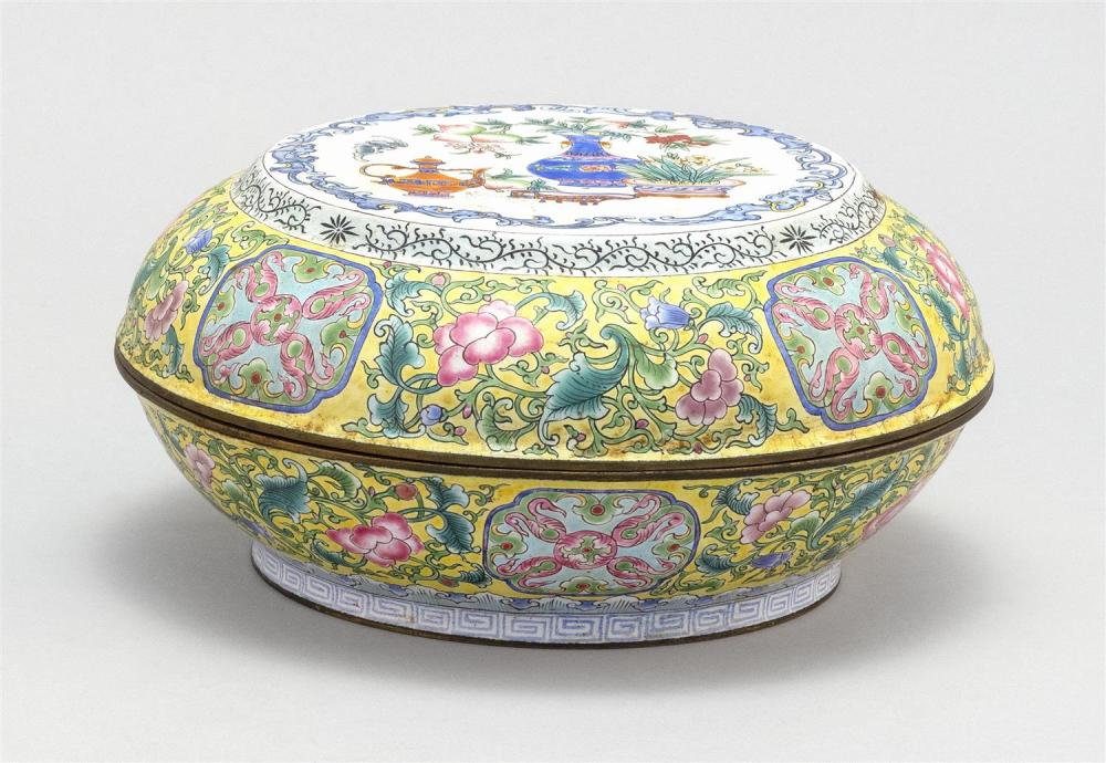 CHINESE PAINTED BEIJING ENAMEL BOX Circular, with bronze vessel design on a yellow floral ground. Six-character Qianlong mark on bas...