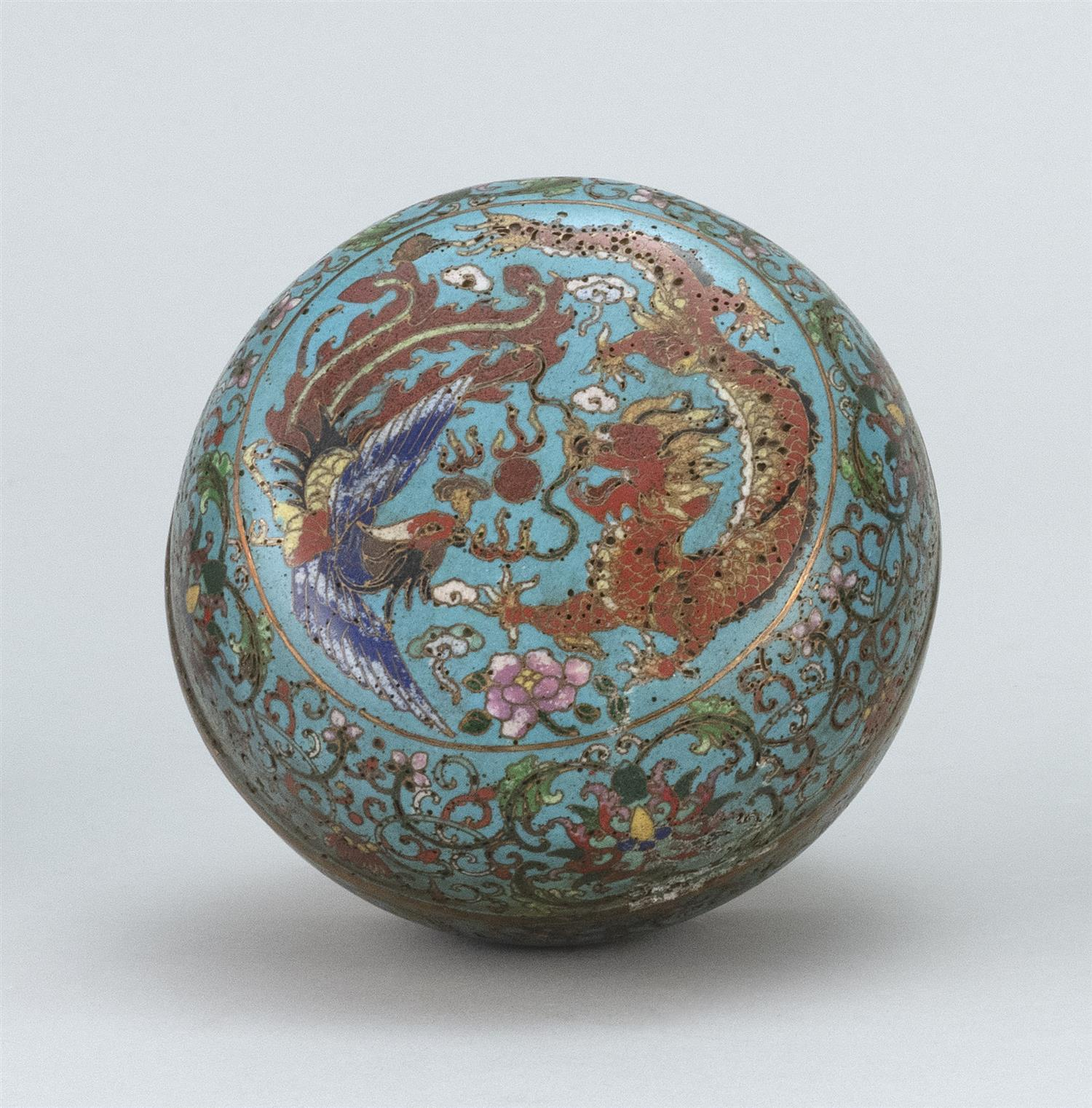 CHINESE CLOISONNÉ ENAMEL BOX In ovoid form, with phoenix and dragon design on a blue passionflower ground. Four-character Qilong mar...
