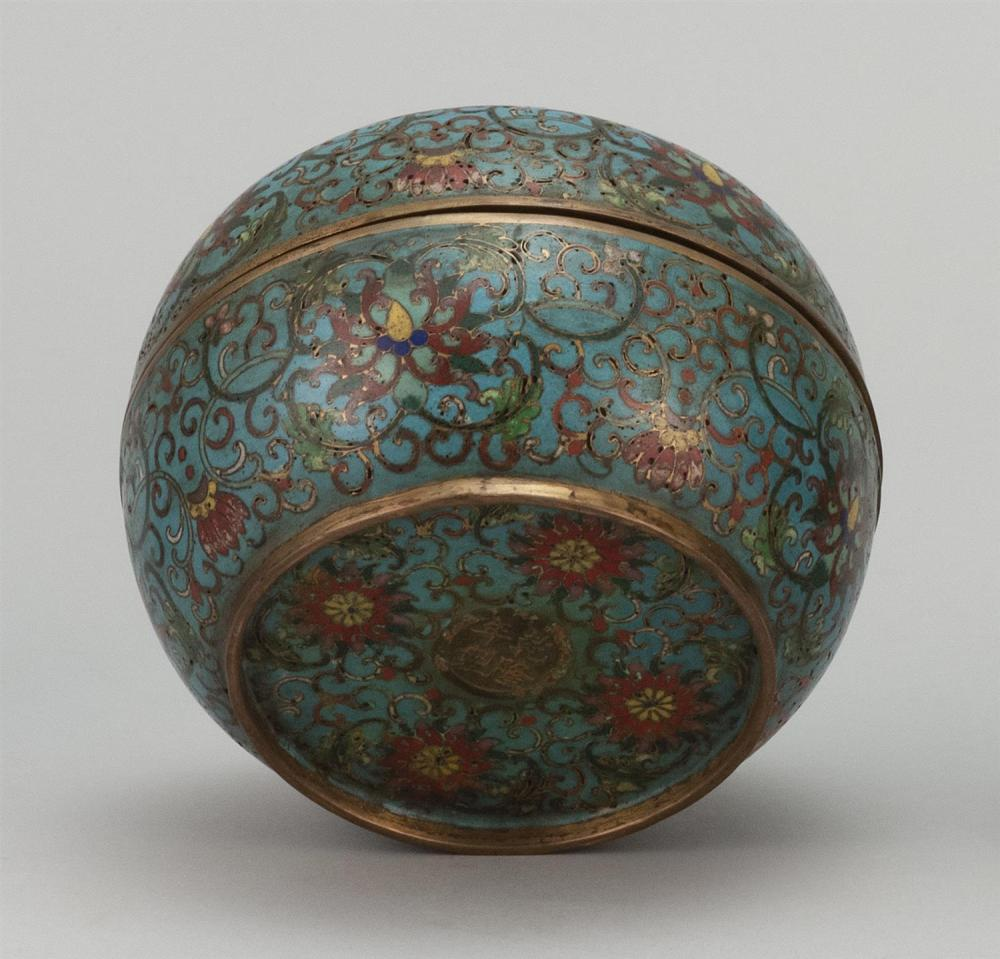 Lot 912: CHINESE CLOISONNÉ ENAMEL BOX In ovoid form, with phoenix and dragon design on a blue passionflower ground. Four-character Qilong mar...