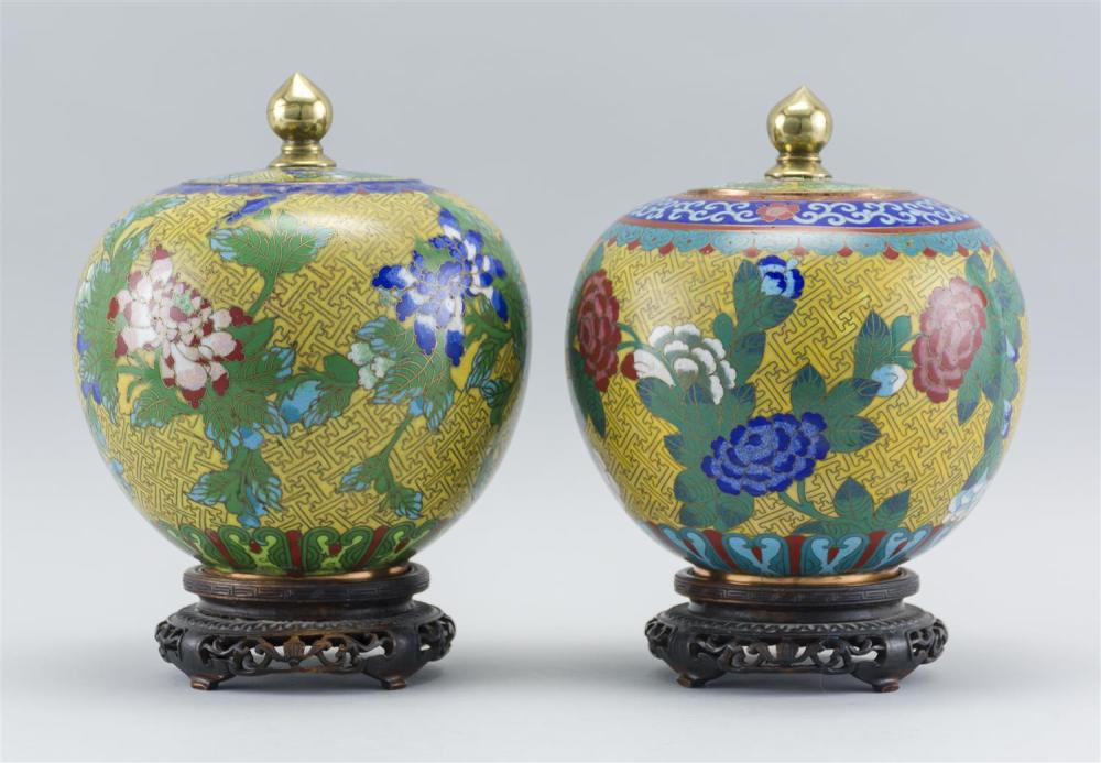 "PAIR OF CHINESE CLOISONNÉ ENAMEL COVERED JARS In ovoid form, with a floral design on a yellow fretwork ground. Heights 7.5"". Include..."