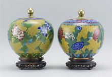 """Lot 914: PAIR OF CHINESE CLOISONNÉ ENAMEL COVERED JARS In ovoid form, with a floral design on a yellow fretwork ground. Heights 7.5"""". Include..."""