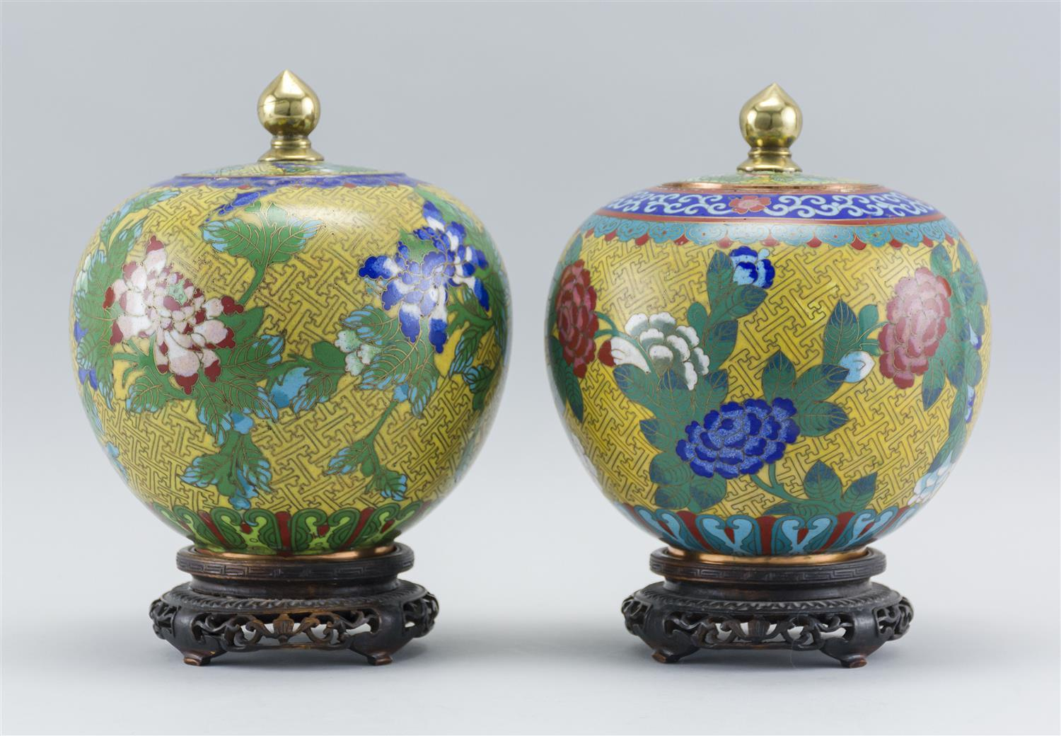 """PAIR OF CHINESE CLOISONNÉ ENAMEL COVERED JARS In ovoid form, with a floral design on a yellow fretwork ground. Heights 7.5"""". Include..."""