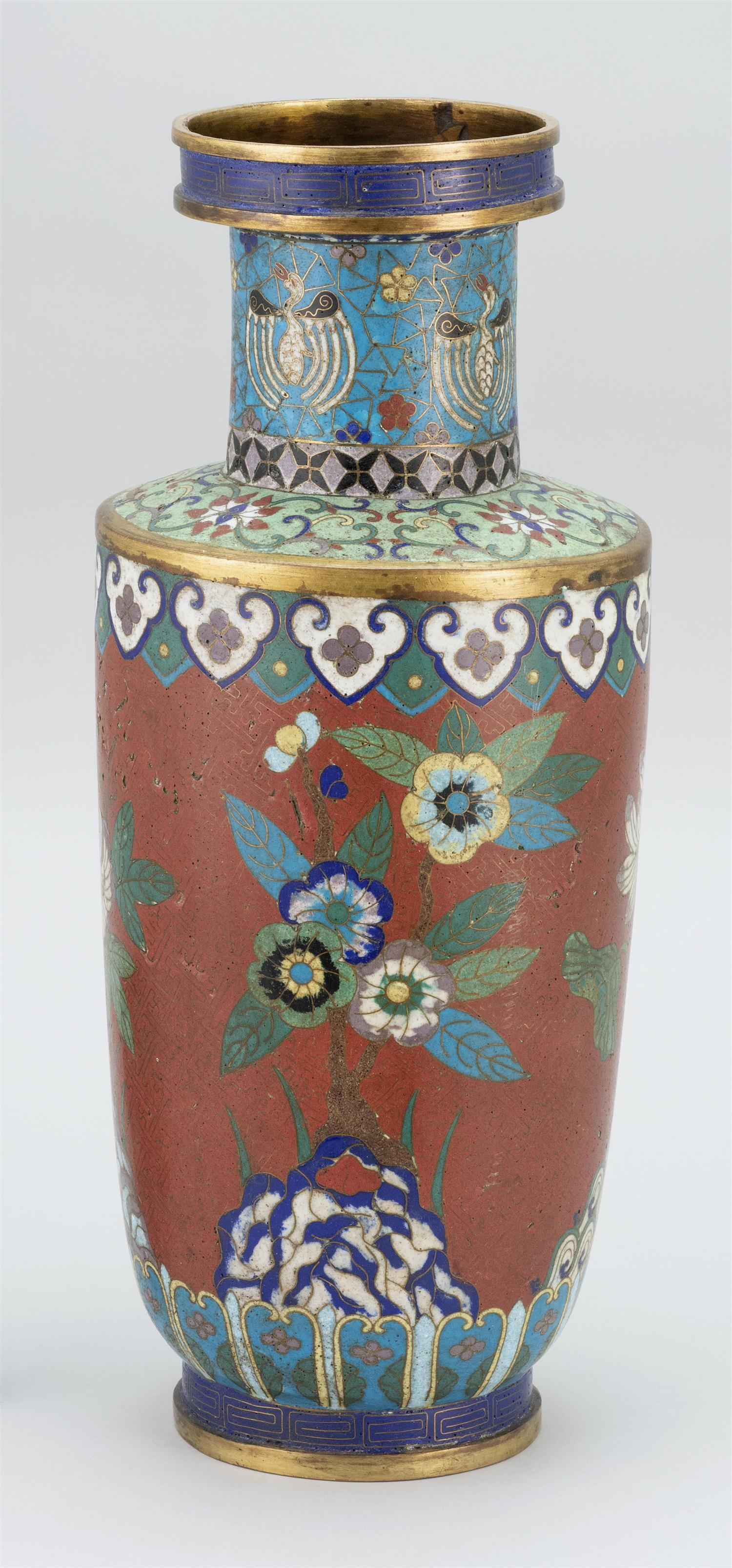 """CHINESE CLOISONNÉ VASE In rouleau form, with stylized cranes at neck and a floral design on a brick red ground. Height 17""""."""