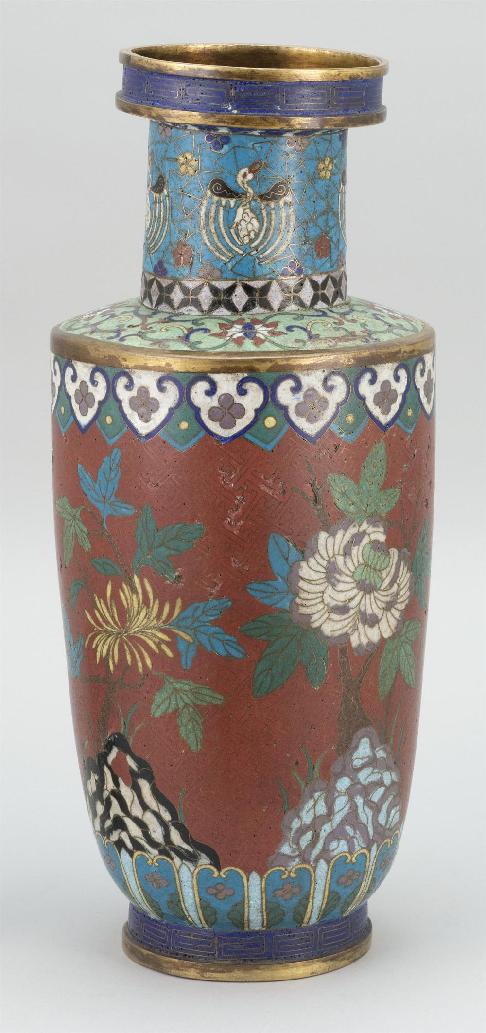 CHINESE CLOISONNÉ VASE In rouleau form, with stylized cranes at neck and a floral design on a brick red ground. Height 17