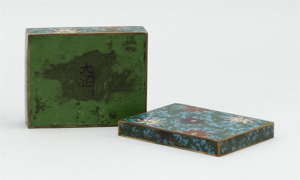 "Lot 918: CHINESE CLOISONNÉ ENAMEL COVERED BOX Rectangular, with passionflower design on a blue ground. Two-character ""Ta Ming"" mark on base...."