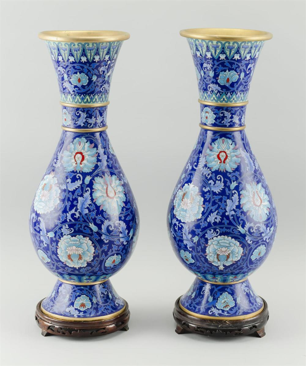 PAIR OF CHINESE CLOISONNÉ ENAMEL VASES In baluster form, with gilt metal banding at neck and decoration of turquoise lotus flowers o...