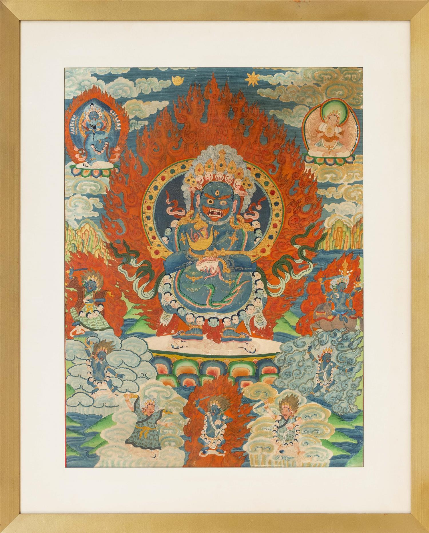 TIBETAN THANKA Depicting Mahakala wearing a skull apron and dancing on two prostrate figures and surrounded by various other deities...