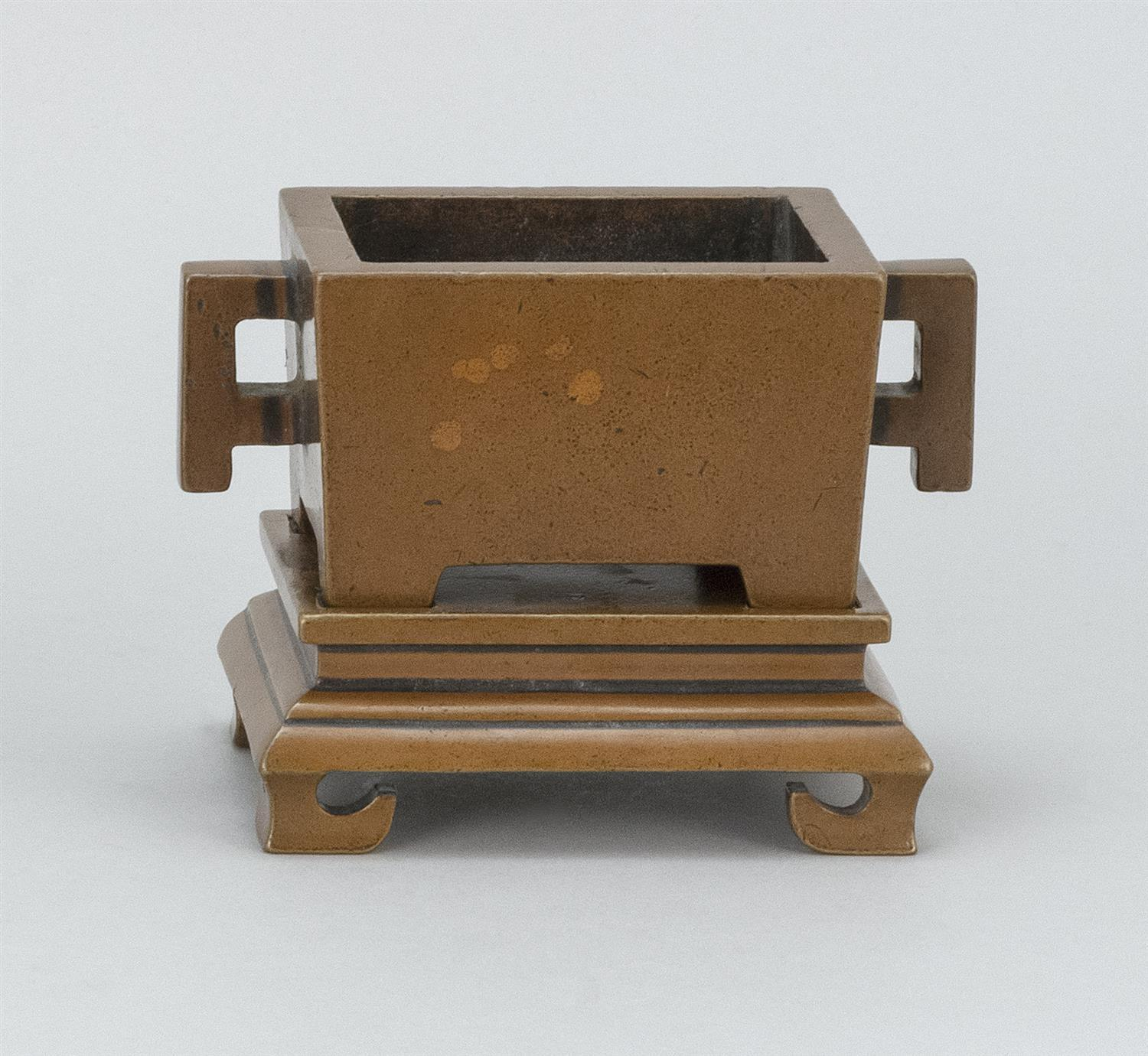 """CHINESE BRONZE CENSER Rectangular, with applied handles and conforming base. Two-character mark beneath censer. Length 5.25""""."""