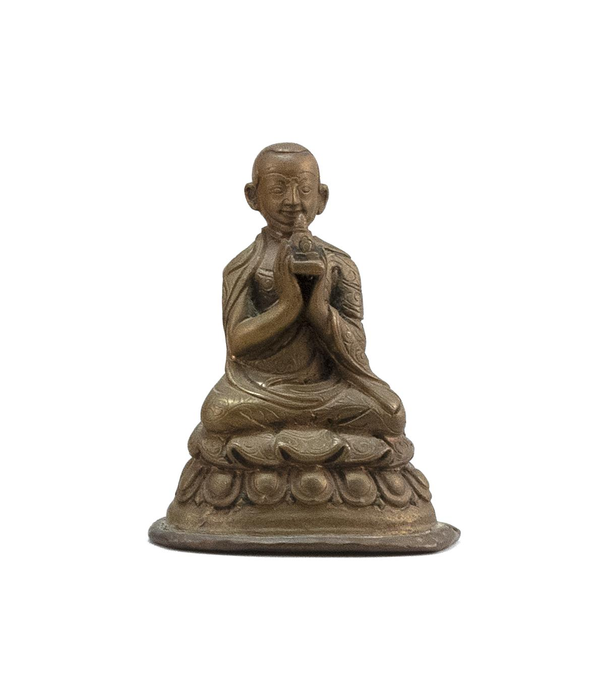 "SINO-TIBETAN BRONZE FIGURE OF A SEATED LAMA Holding a stupa and resting on a lotus throne. Height 3""."