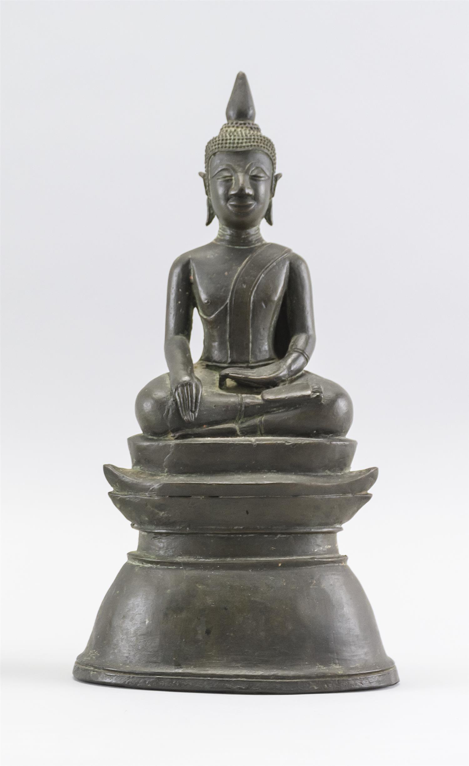 "TIBETAN BRONZE FIGURE OF BUDDHA Seated in an earth touching position on a raised oval base. Height 11.5""."