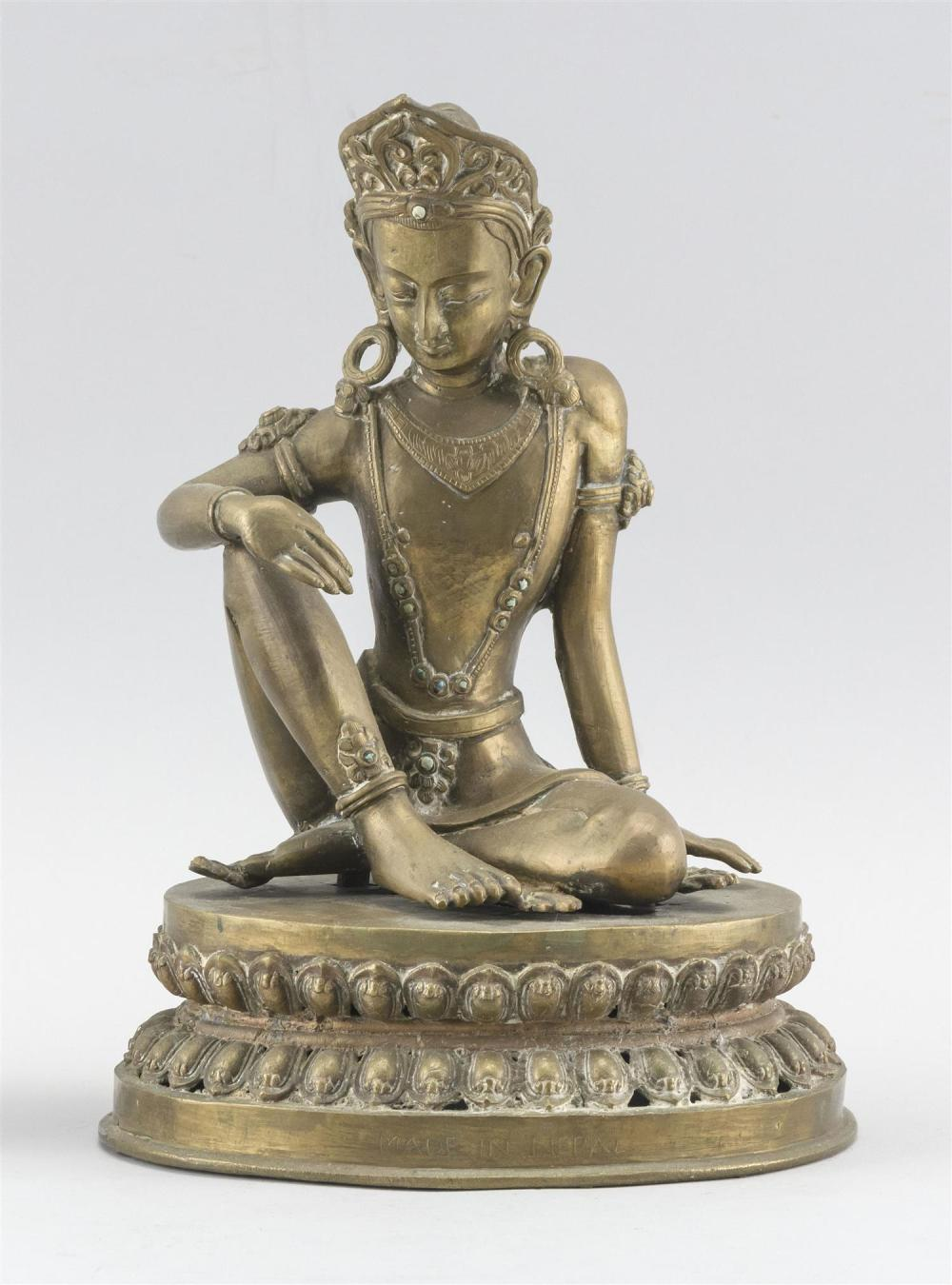 "NEPALESE BRONZE FIGURE OF BUDDHA Seated on a lotus base. Paper label affixed to back. Height 10""."