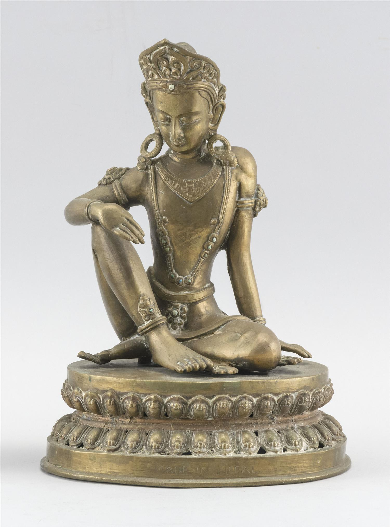 """NEPALESE BRONZE FIGURE OF BUDDHA Seated on a lotus base. Paper label affixed to back. Height 10""""."""