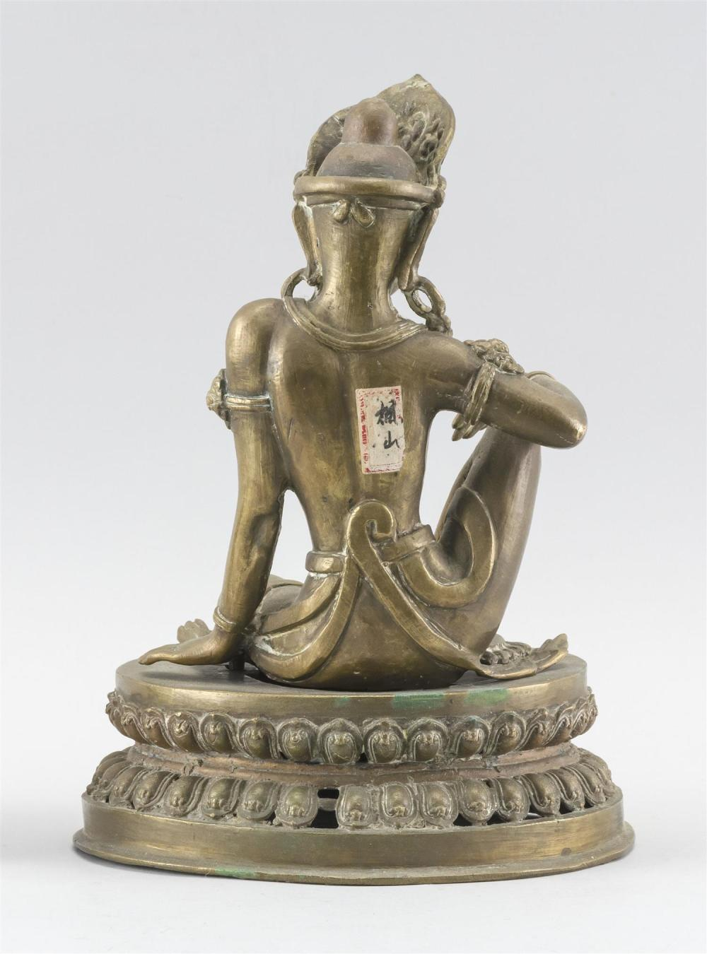 NEPALESE BRONZE FIGURE OF BUDDHA Seated on a lotus base. Paper label affixed to back. Height 10