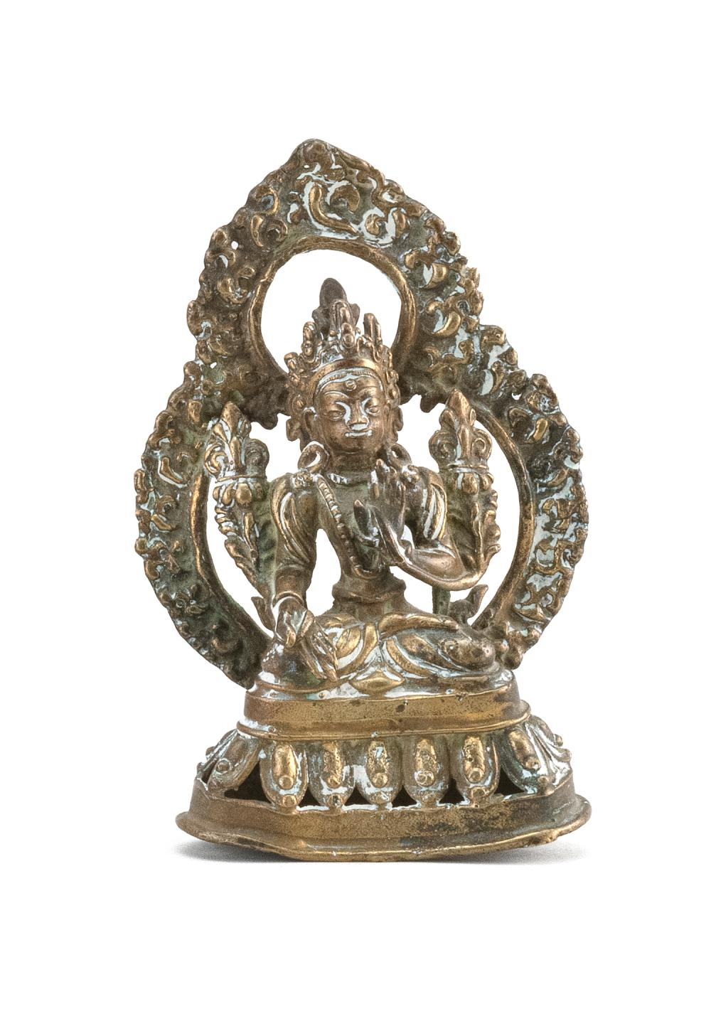 "BRONZE FIGURE OF TARA Seated on a lotus throne with openwork mandala. Height 5""."