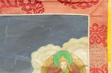 "Lot 936: TIBETAN THANKA In mandala design, with central figure of Mahakala surrounded by various deities. 30"" x 22""."