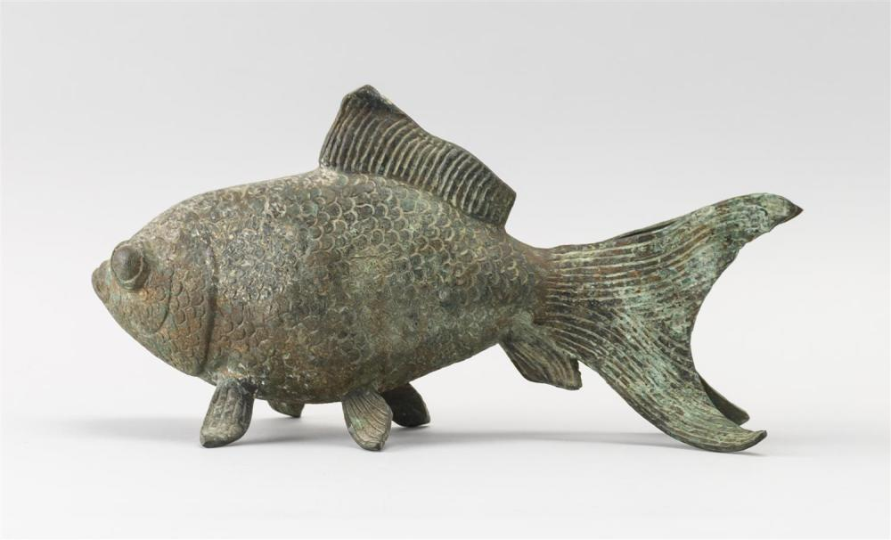 """Lot 938: CHINESE BRONZE FIGURE OF A KOI Resting on its fins. Green patina. Length 12""""."""