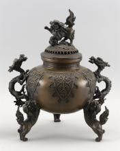 Lot 943: CHINESE BRONZE CENSER In ovoid form, with dragon handles and three lion feet. Domed cover with lion finial. Circular mark on base. H...