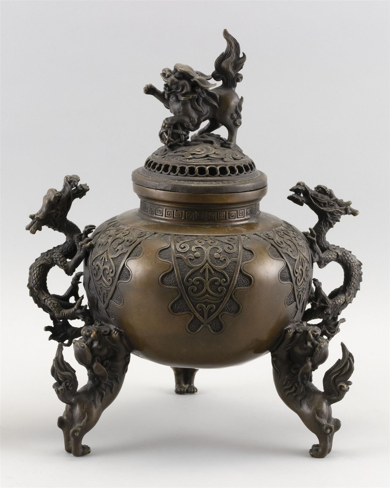 CHINESE BRONZE CENSER In ovoid form, with dragon handles and three lion feet. Domed cover with lion finial. Circular mark on base. H...