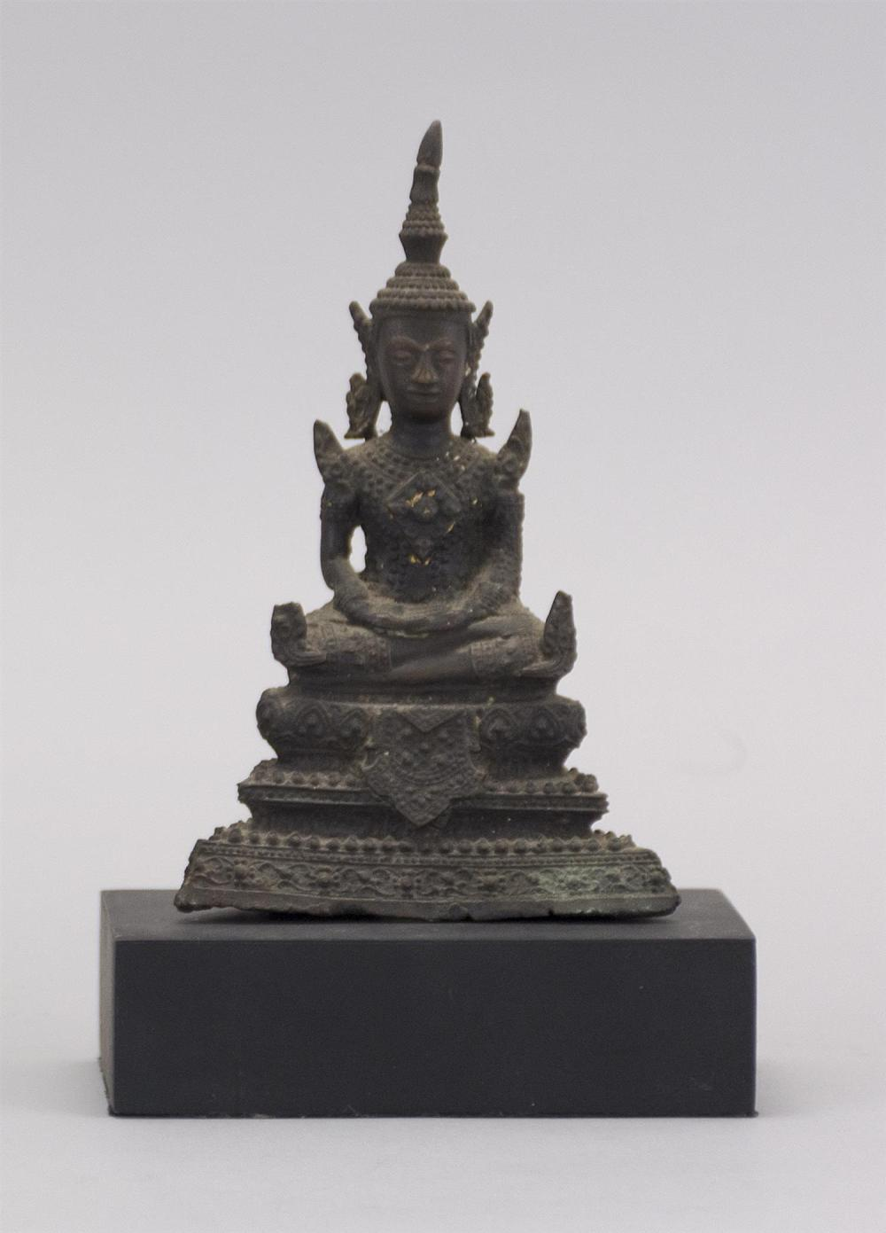 "THAI BRONZE BUDDHA Seated on a lotus throne. Traces of original gilding. Height 5"". Hollow base."