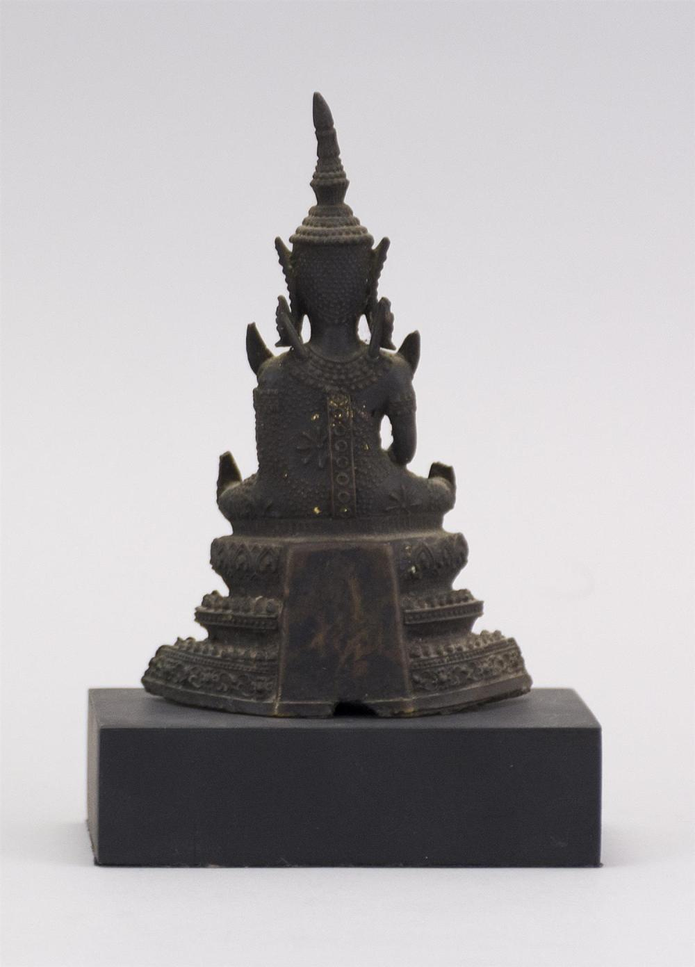 "Lot 944: THAI BRONZE BUDDHA Seated on a lotus throne. Traces of original gilding. Height 5"". Hollow base."