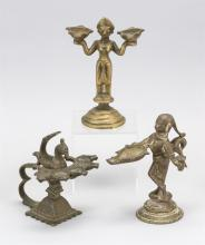 Lot 945: SEVEN INDIAN BRASS OIL LAMPS Five with five wick holders, one in the form of a bird, and one with two wick holders and one with one...