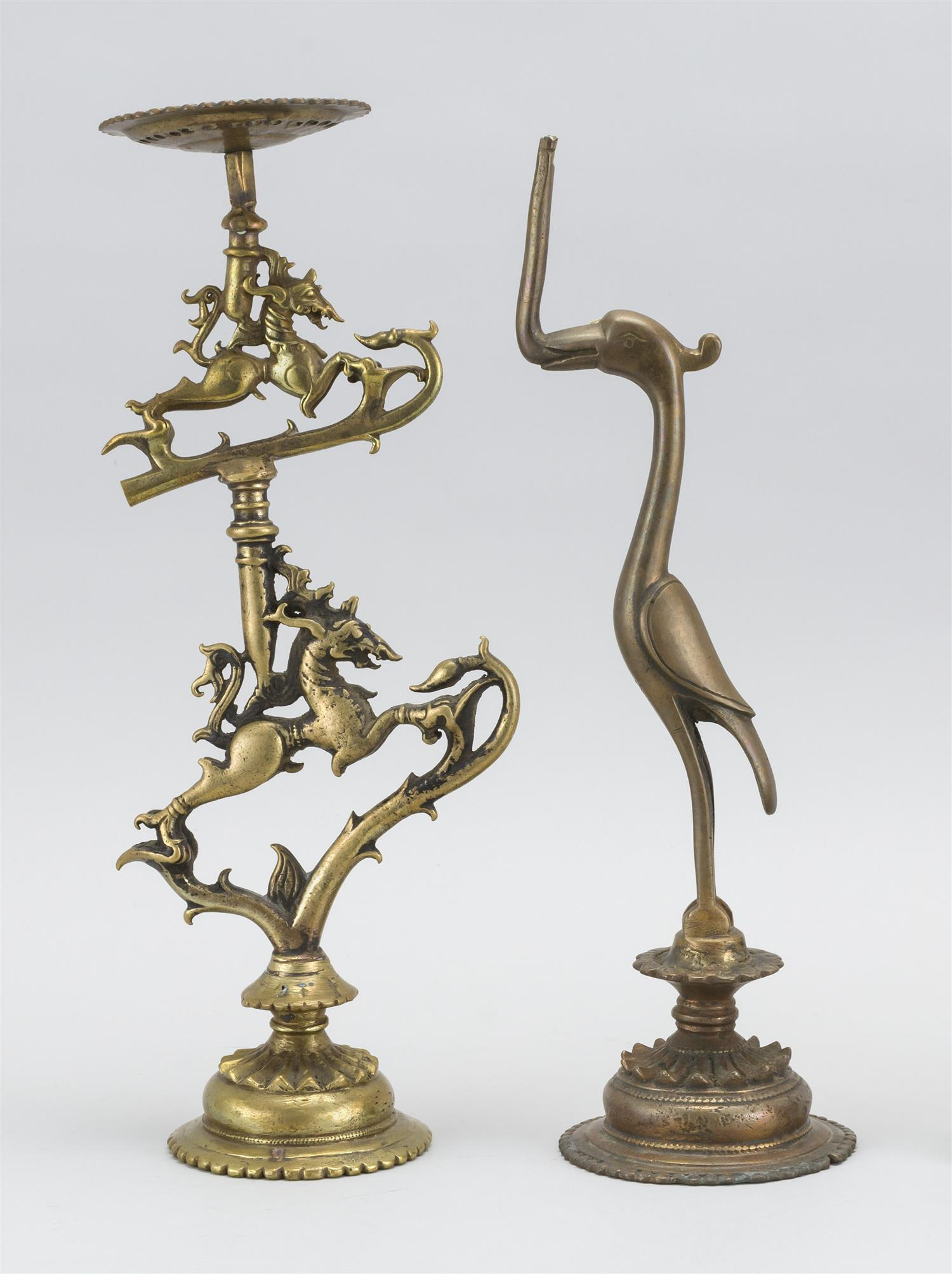 """TWO PIECES OF INDIAN METALWARE A bronze altar stand in a horse-like creature design, height 13"""", and a bird-form base for an altar s..."""