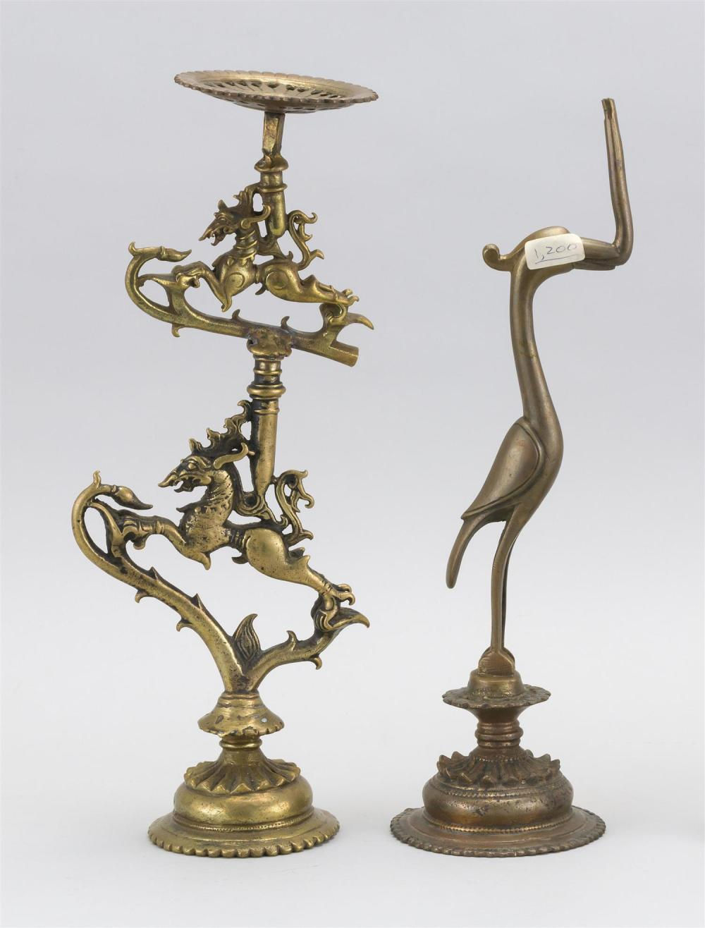 "Lot 948: TWO PIECES OF INDIAN METALWARE A bronze altar stand in a horse-like creature design, height 13"", and a bird-form base for an altar s..."