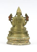 """Lot 951: SINO-TIBETAN BRONZE FIGURE OF A LAMA Seated on a lotus stand. Height 4.25"""". Includes a brocade stand."""