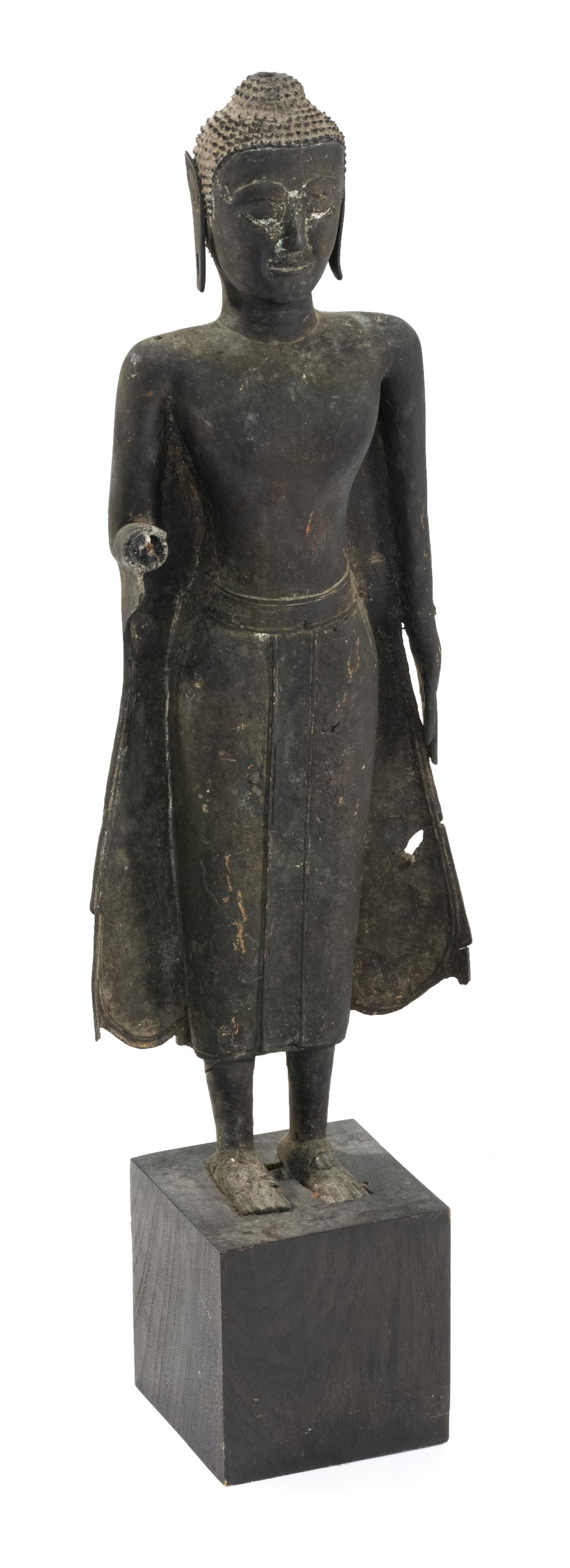 "THAI BRONZE FIGURE OF BUDDHA Standing and in a flared skirt. Height 27"", not inclusive of base."