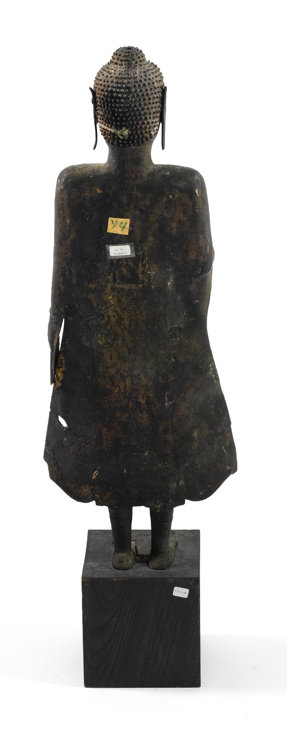 "Lot 952: THAI BRONZE FIGURE OF BUDDHA Standing and in a flared skirt. Height 27"", not inclusive of base."