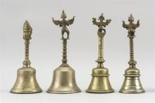 """Lot 953: FOUR INDIAN BRASS TEMPLE BELLS One with an elephant handle, height 9.75"""", one with a bird-like handle, height 11"""", and two in a simi..."""