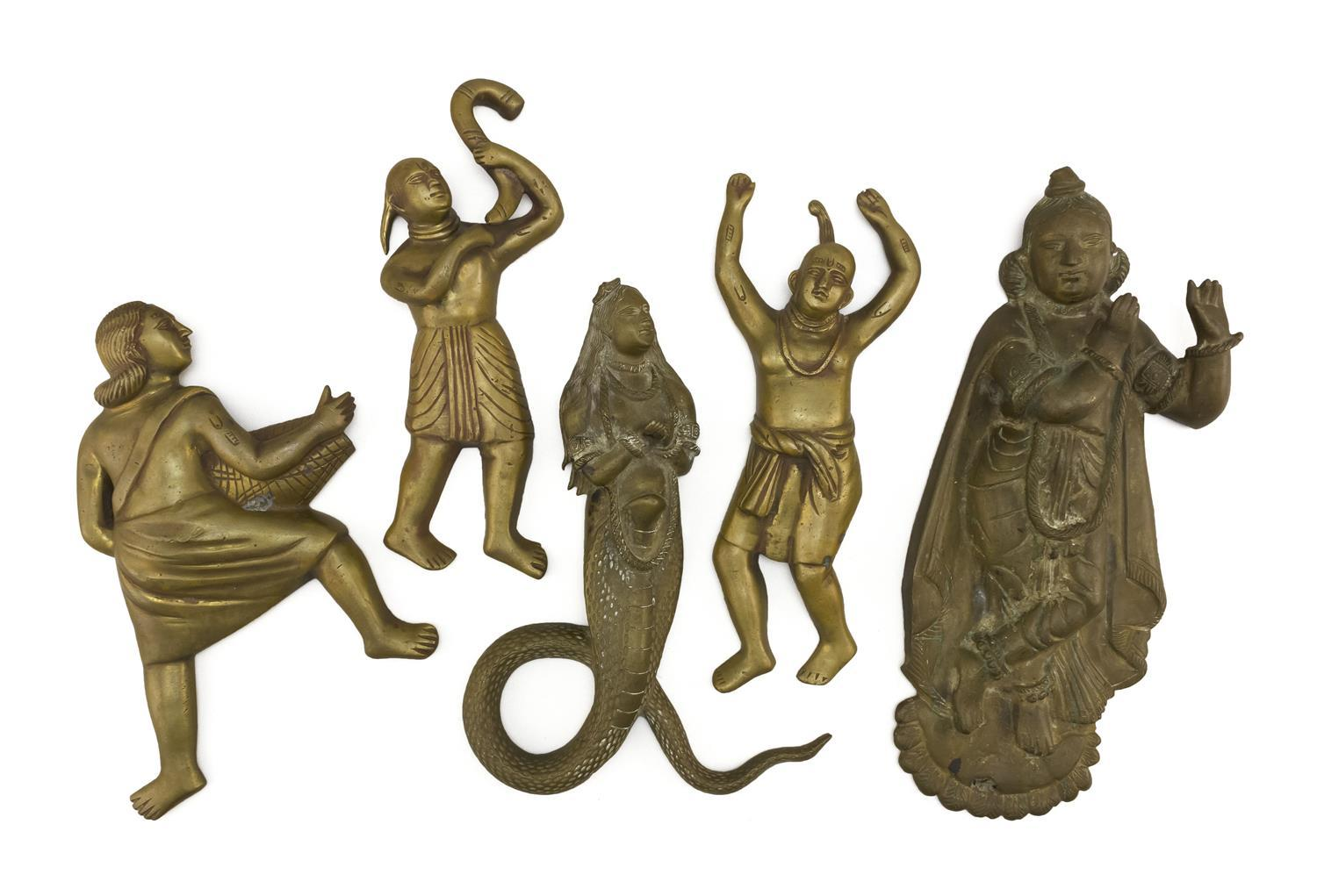 """FIVE INDIAN BRASS FIGURAL PLAQUES A man with a basket, height 8.5"""", a mermaid, height 11"""", a man with a trumpet, height 10.25"""", a ma..."""