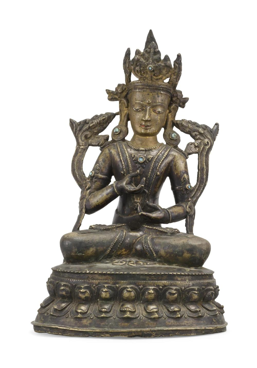 "NEPALESE BRONZE FIGURE OF BUDDHA In seated position on a lotus throne. Inset turquoise details. Height 10.25""."
