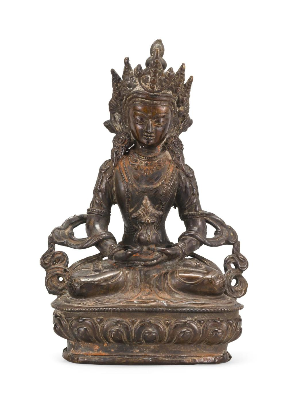 "NEPALESE BRONZE FIGURE OF BUDDHA Seated on a lotus throne and holding a censer. Height 8.5""."