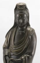 Lot 959: FINELY CAST SHISOU SILVER-INLAID BRONZE FIGURE OF GUANYIN Standing and draped in cloud-inlaid robes. Four-character inscription on b...