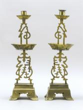 "Lot 963: PAIR OF CHINESE BRASS CANDLESTICKS Openwork calligraphy stems with lozenge-form drip cups. Footed bases. Heights 16""."