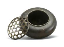 """Lot 964: CHINESE BRONZE CENSER In ovoid form, with tripod base. Iron openwork basketry cover. Height 3"""". Diameter 4""""."""